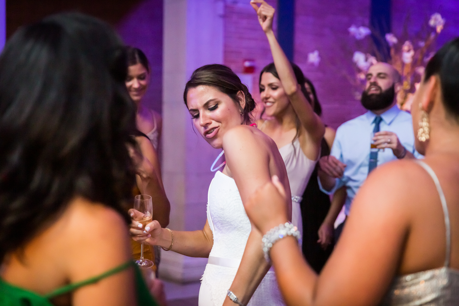 Bride and guests dancing at reception for an article on Bronx Zoo wedding venue updates