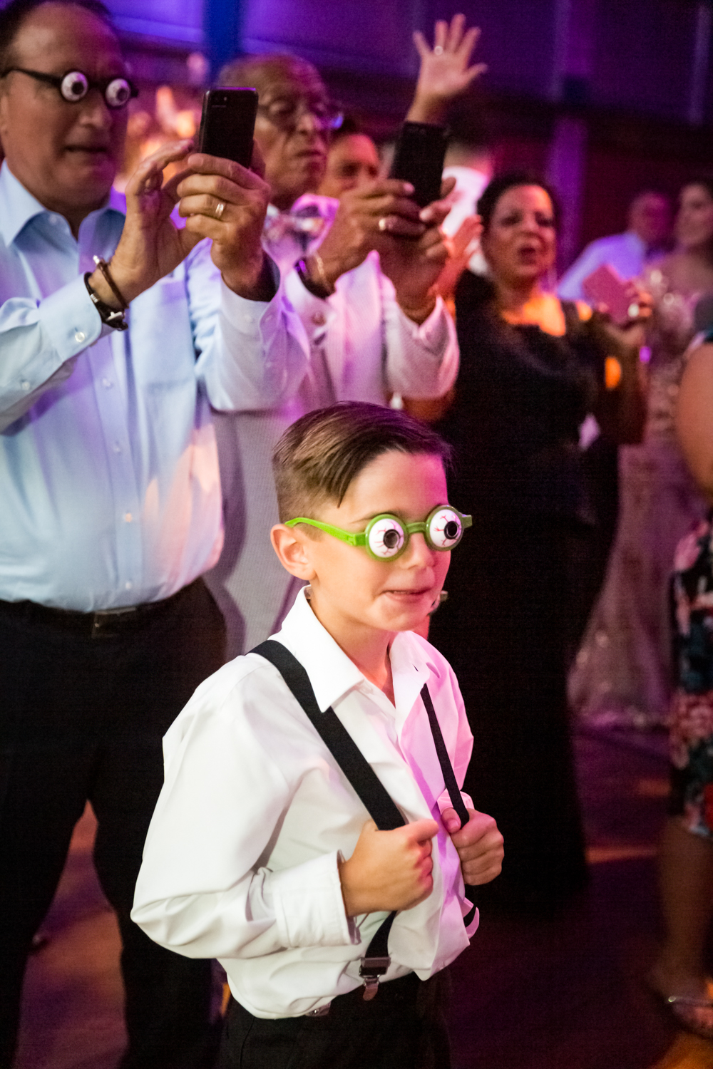 Little boy with fake eye glasses for an article on Bronx Zoo wedding venue updates