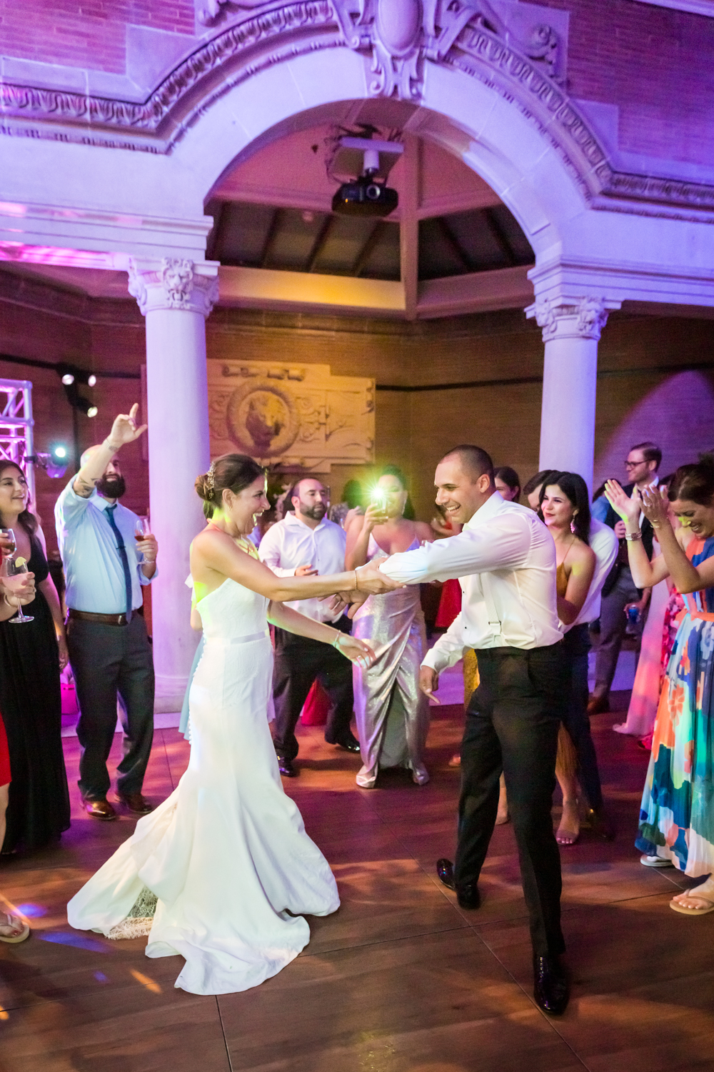 Bride and groom dancing with guests for an article on Bronx Zoo wedding venue updates