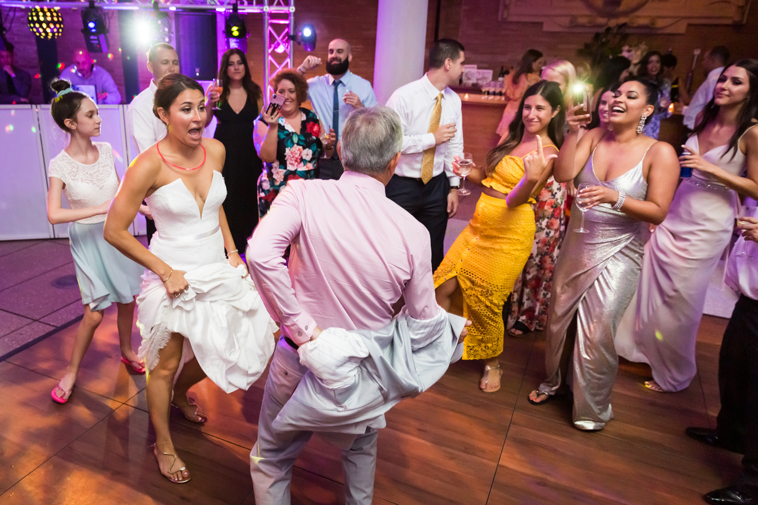 Bride dancing with guests for an article on Bronx Zoo wedding venue updates