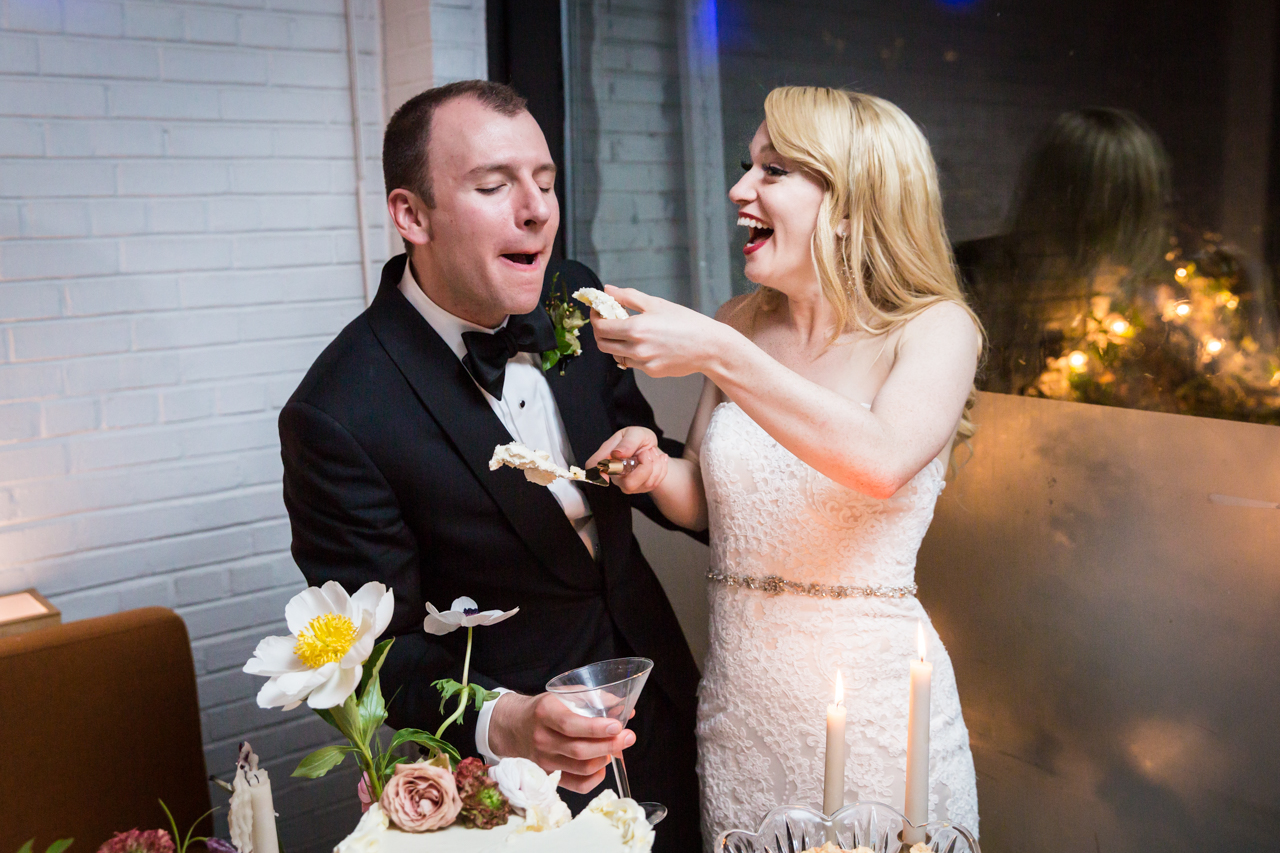 Bride feeding groom cake at a Central Park Conservatory Garden wedding