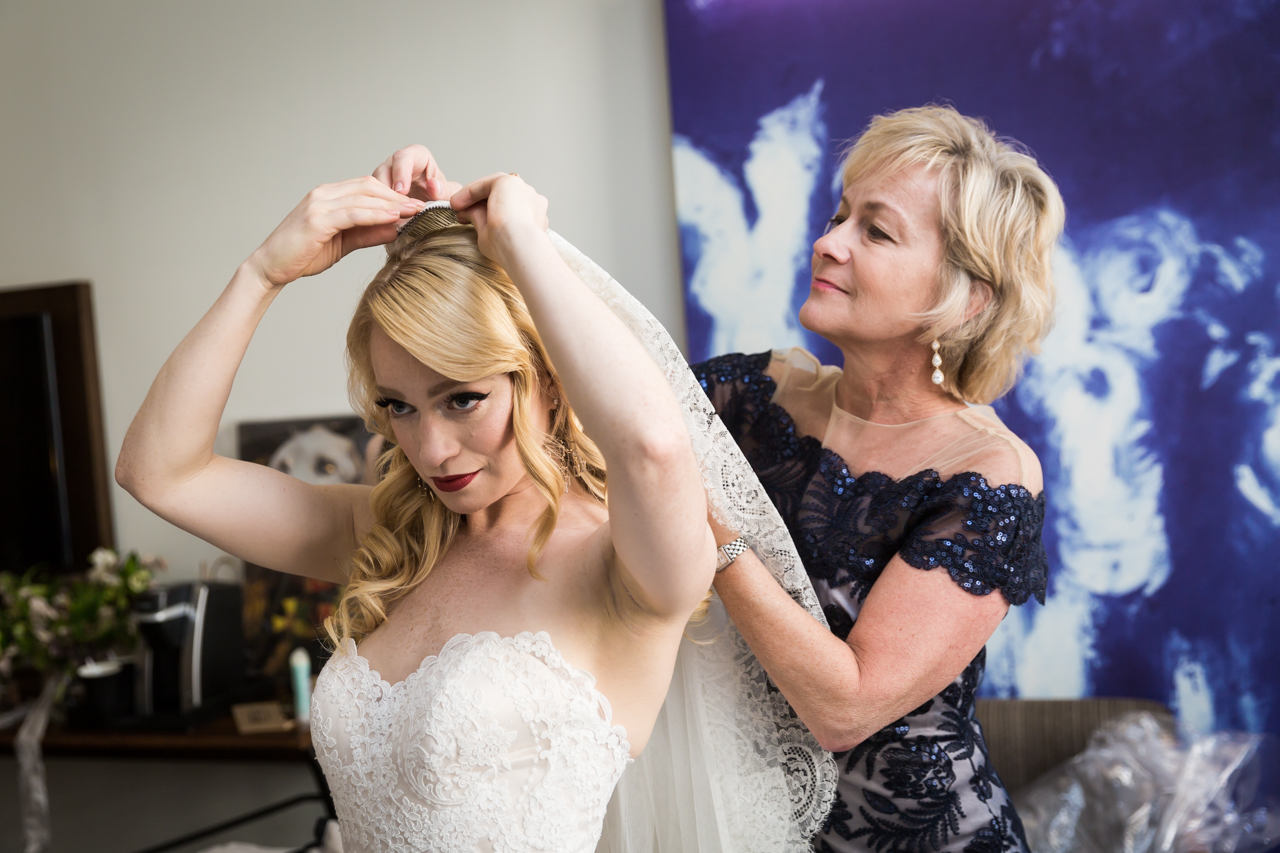 Mother adjusting bride's veil at a Central Park Conservatory Garden wedding