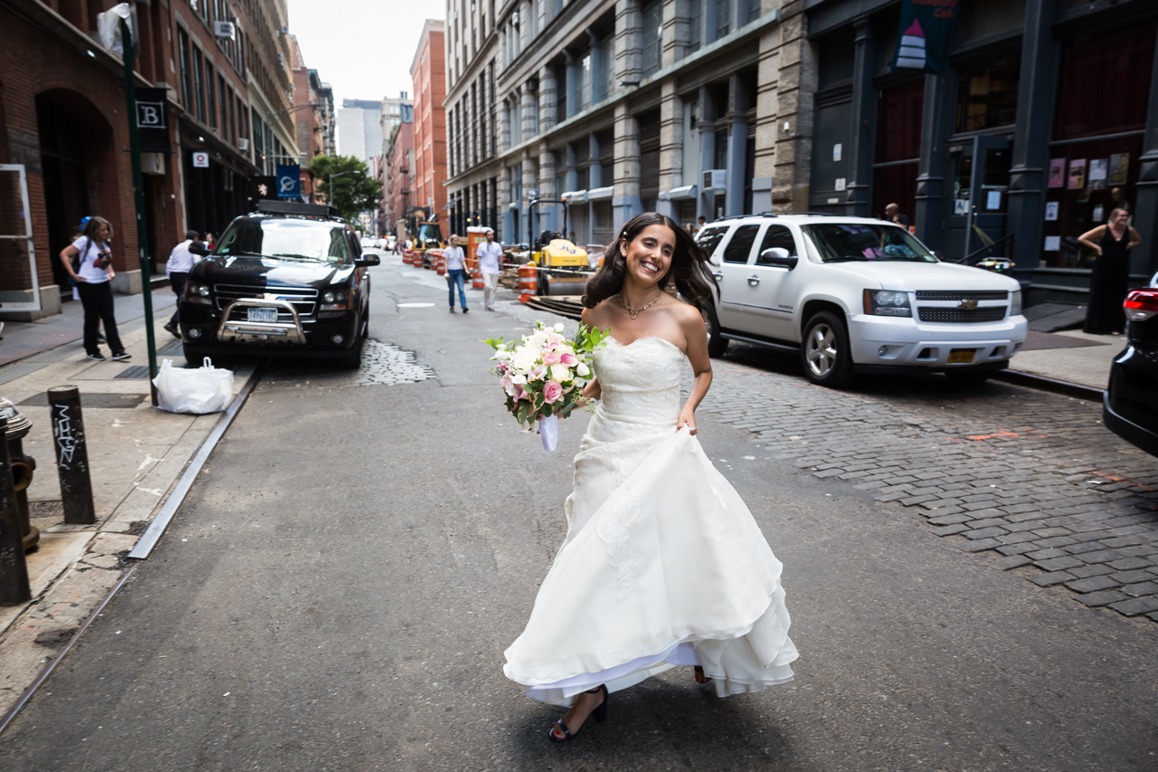 Bride in white dress crossing street for an article on non-floral centerpiece ideas