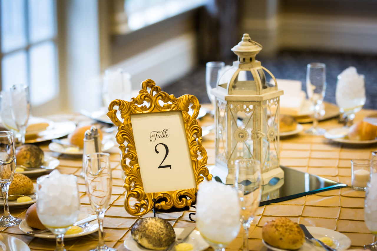 Table setting with lantern and frame for an article on non-floral centerpiece ideas