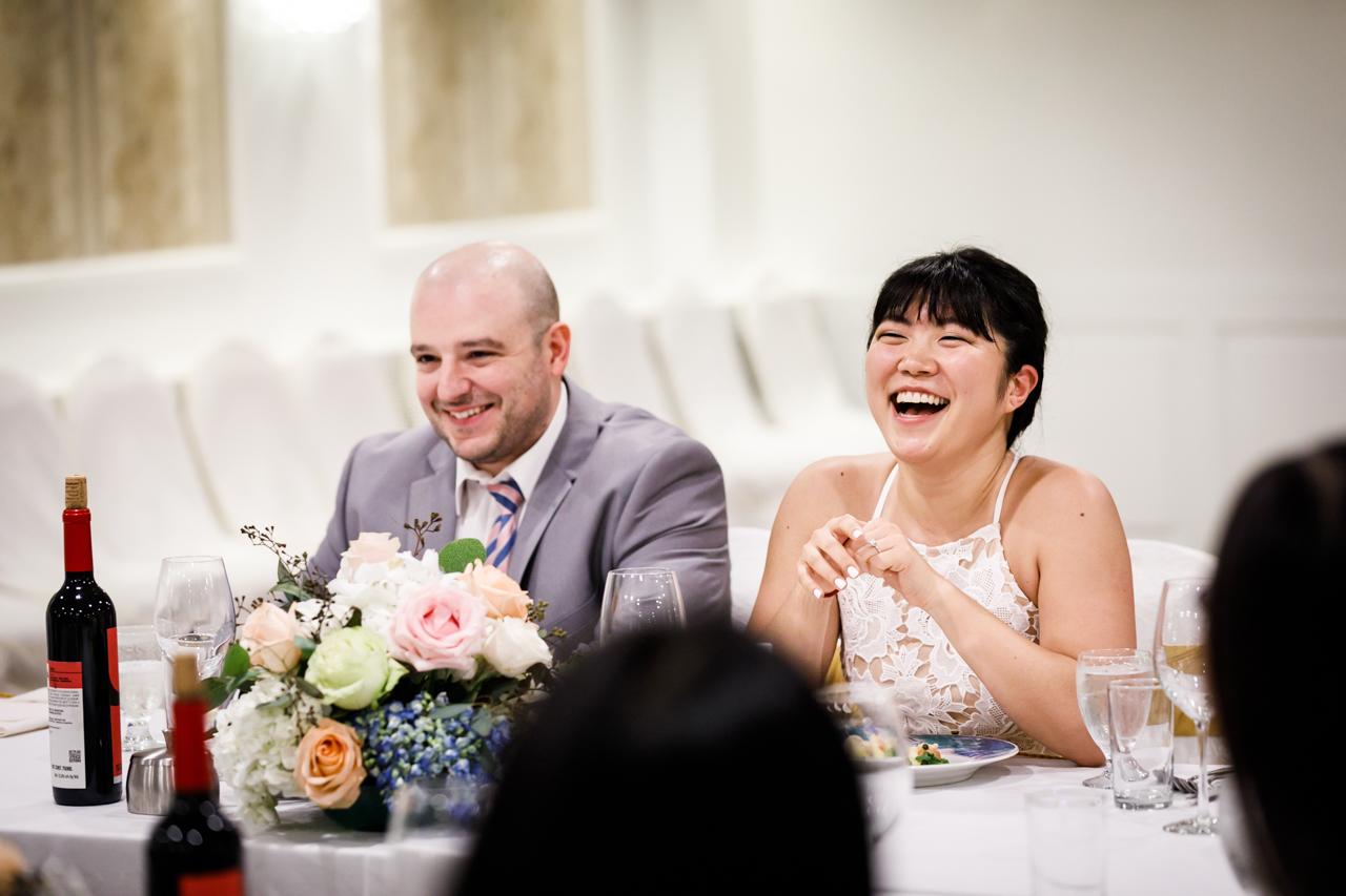 Bride and groom at reception after traditional Korean pyebaek ceremony