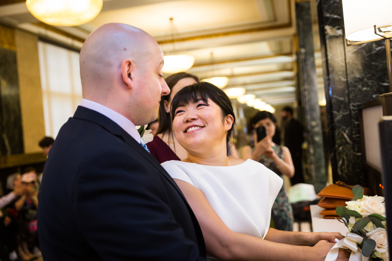 Bride and groom after signing City Hall wedding paperwork