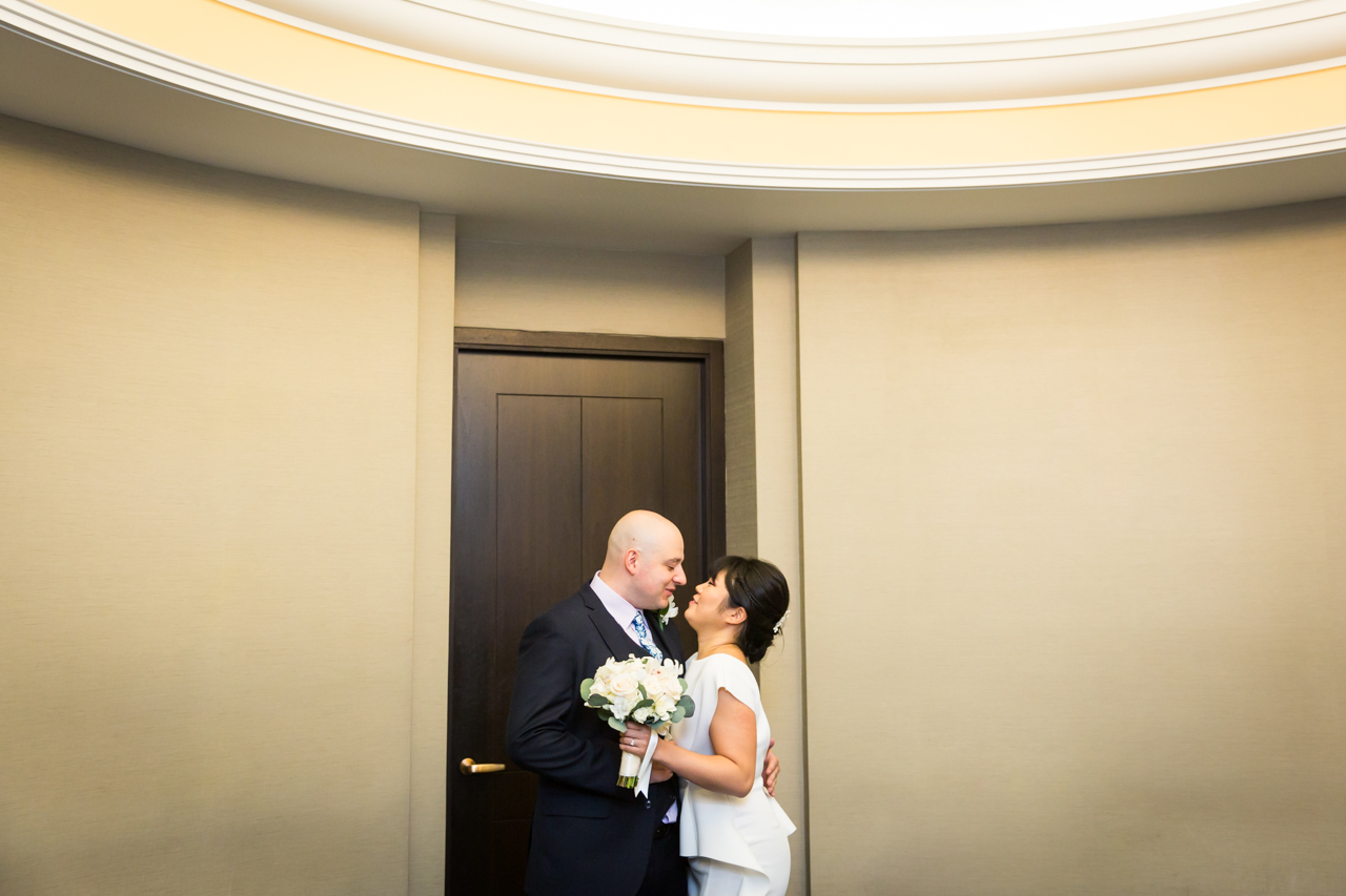 Bride and groom waiting for NYC City Hall wedding ceremony