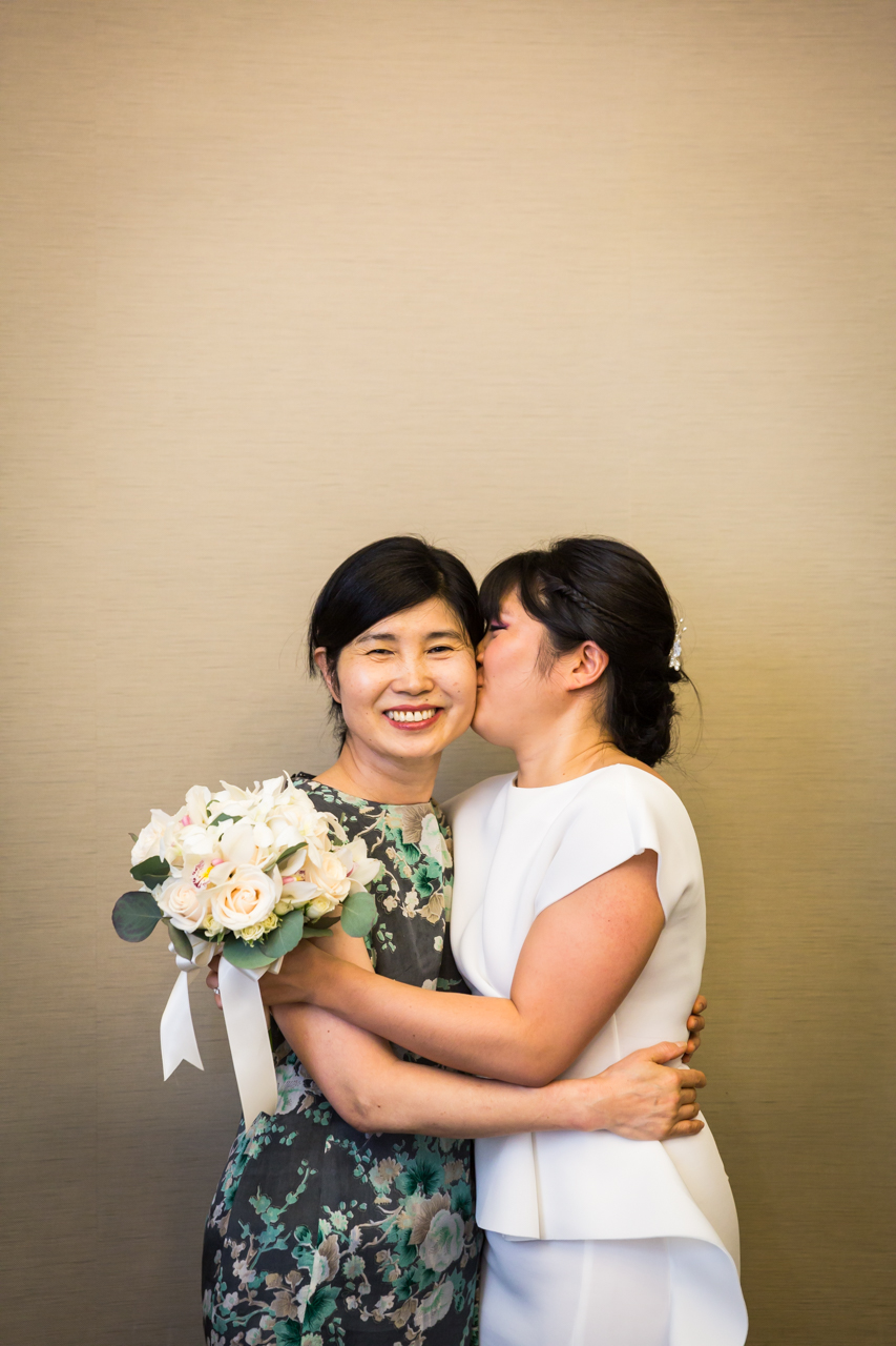 Bride kissing mother before NYC City Hall wedding