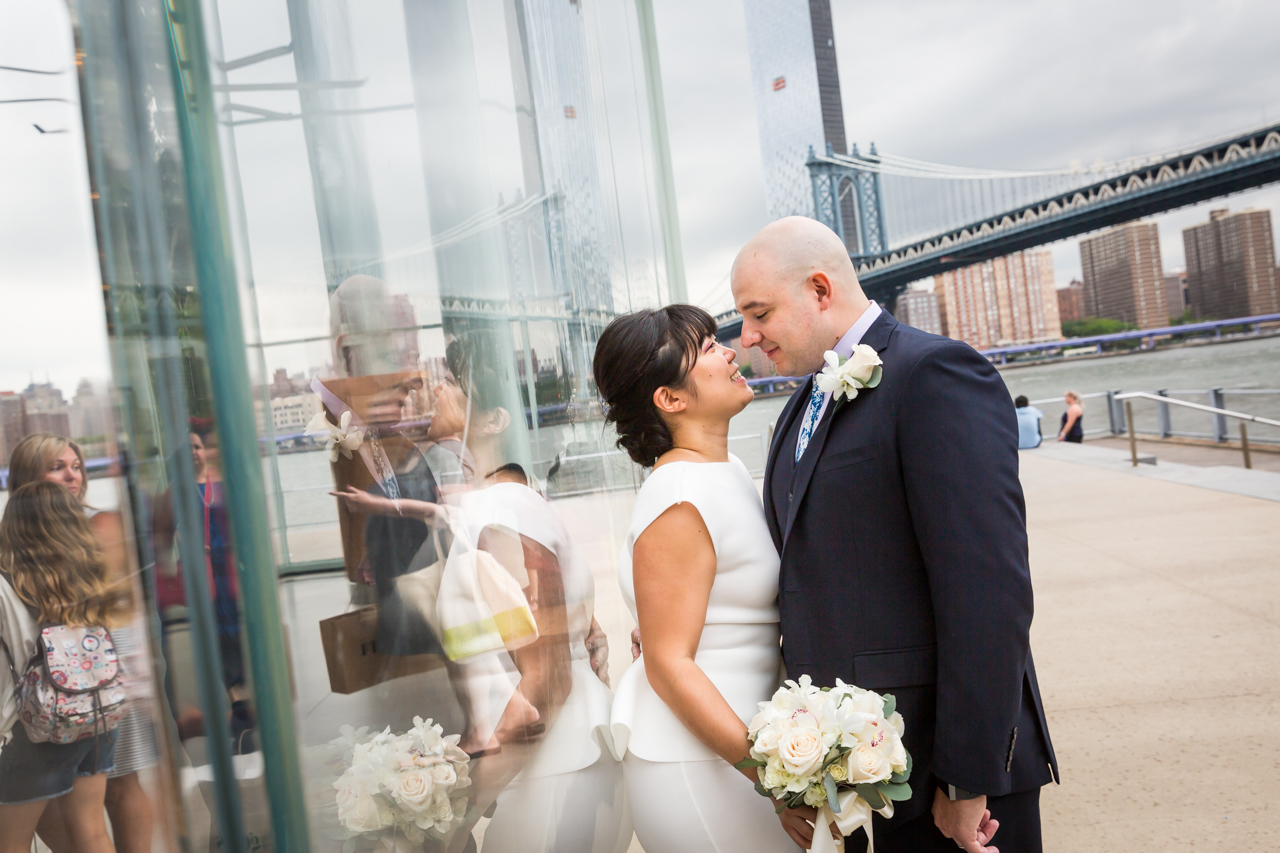Bride and groom kissing against Jane's Carousel