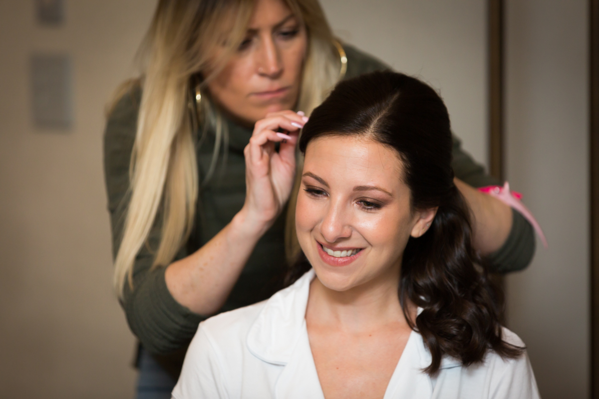 Bride getting hair fixed before a Four Seasons Hotel New York Downtown wedding