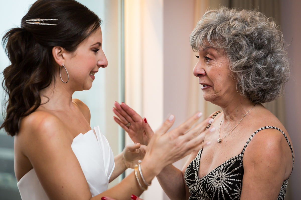 Bride and mother emotional before Four Seasons Hotel New York Downtown wedding
