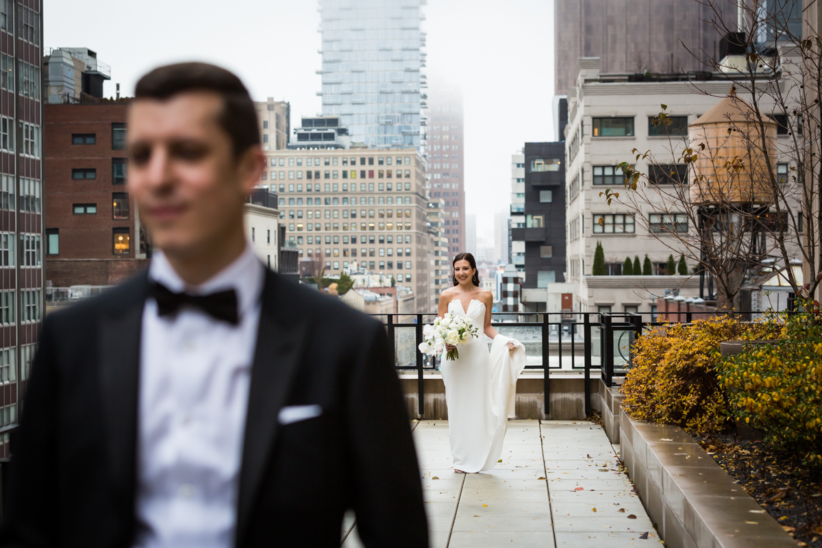 Bride looking at groom before first look at the Four Seasons Hotel New York Downtown