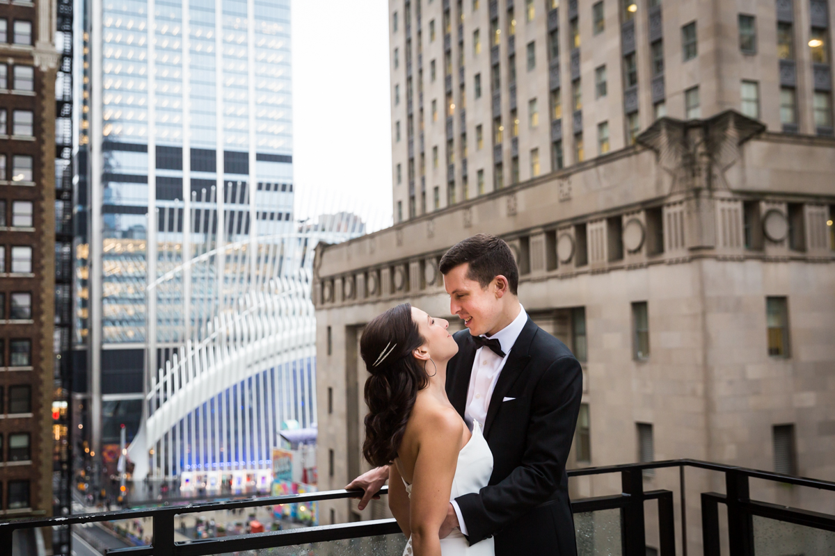 Bride and groom looking at each other on terrace of Four Seasons Hotel New York Downtown