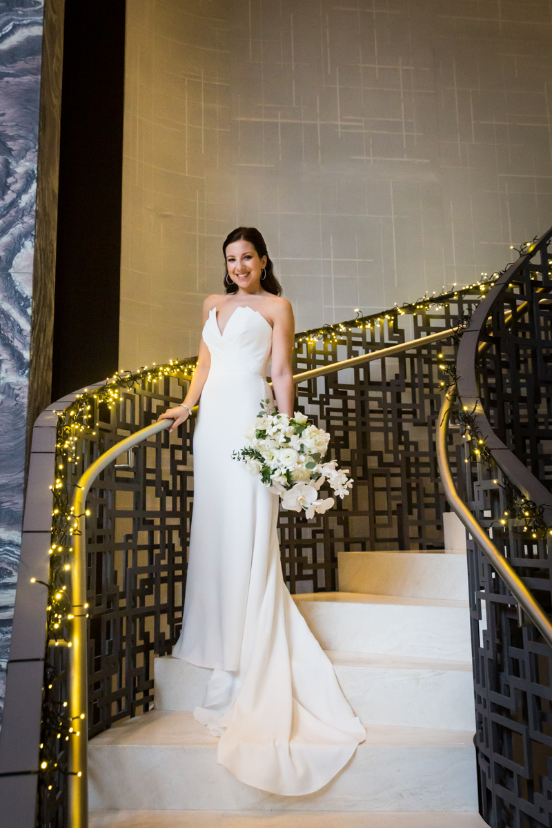 Bride posed on staircase of Four Seasons Hotel New York Downtown