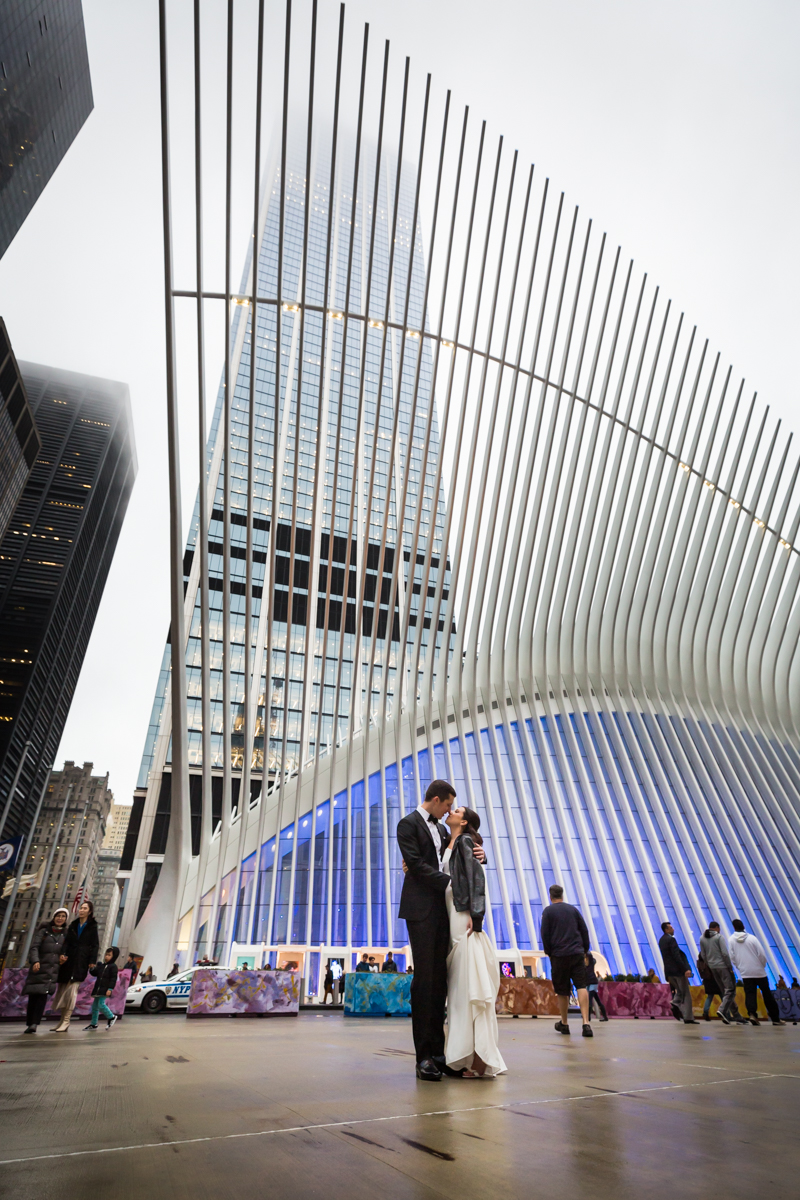Bride and groom posed in front of Oculus in NYC
