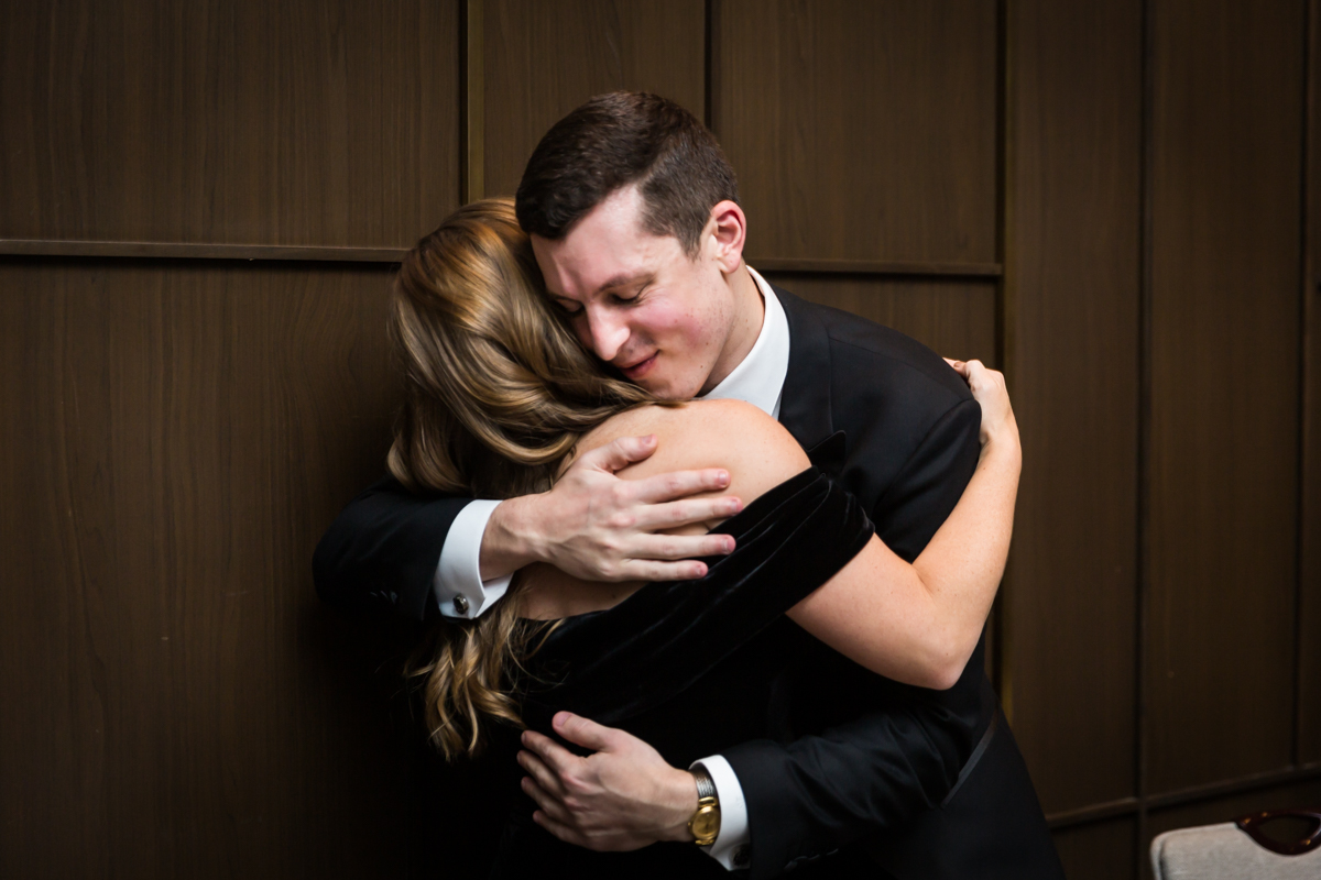 Groom hugging guest after ketubah signing at a Four Seasons Hotel New York Downtown wedding
