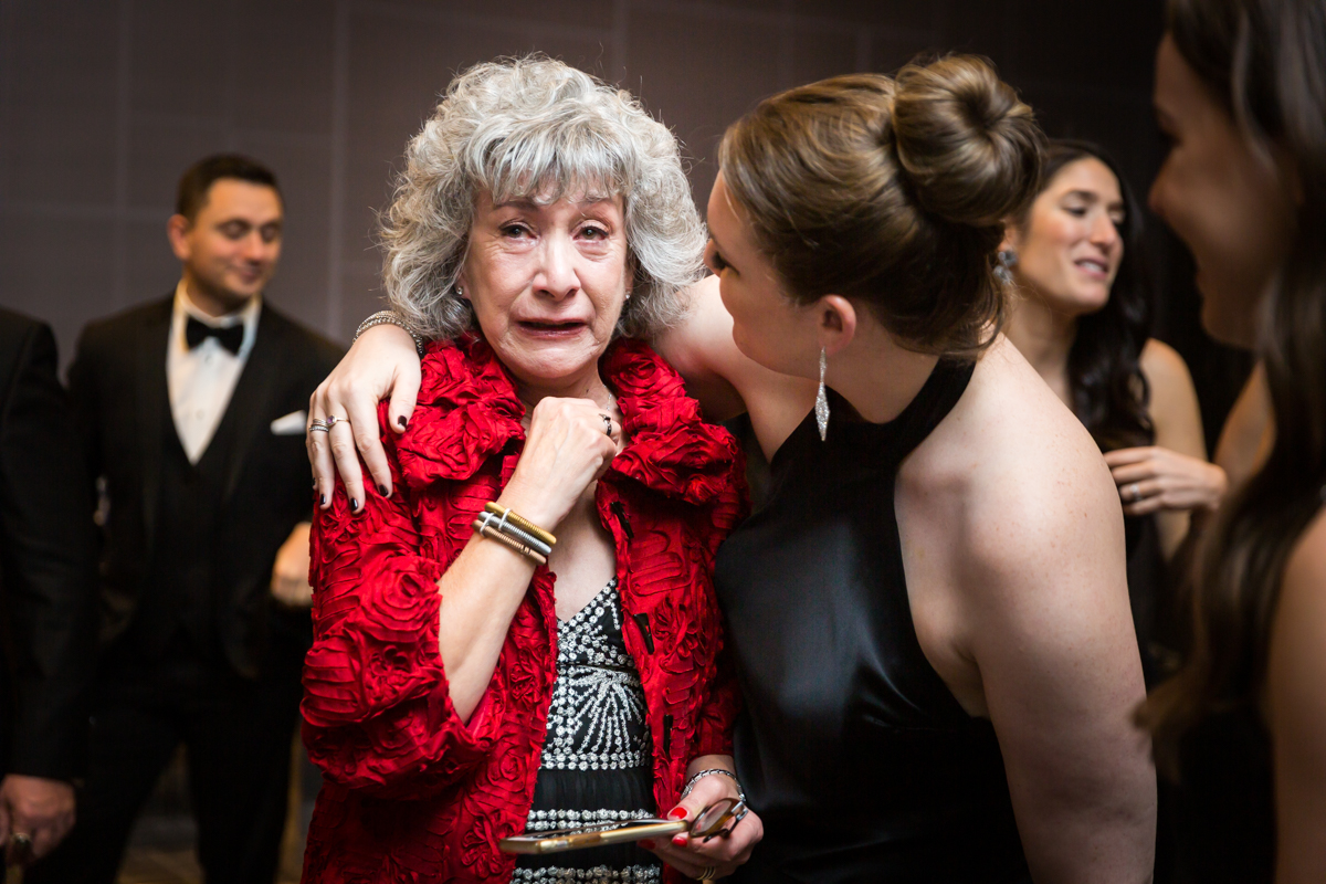 Mother crying after ketubah signing at a Four Seasons Hotel New York Downtown wedding