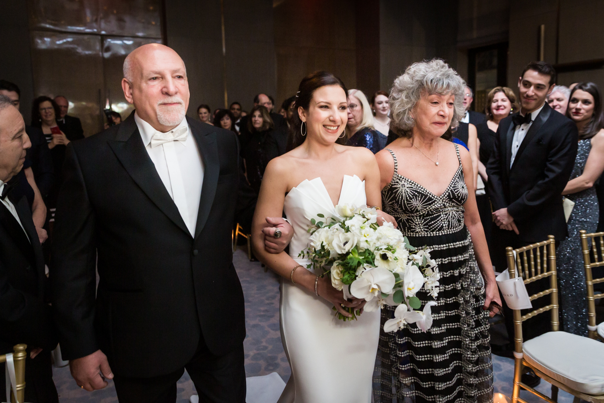 Bride and parents walking down the aisle at a Four Seasons Hotel New York Downtown wedding
