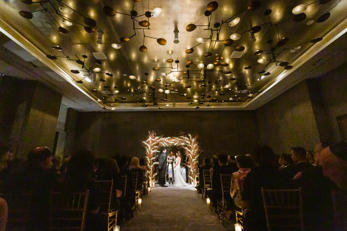 Bride and groom under chuppah at a Four Seasons Hotel New York Downtown wedding