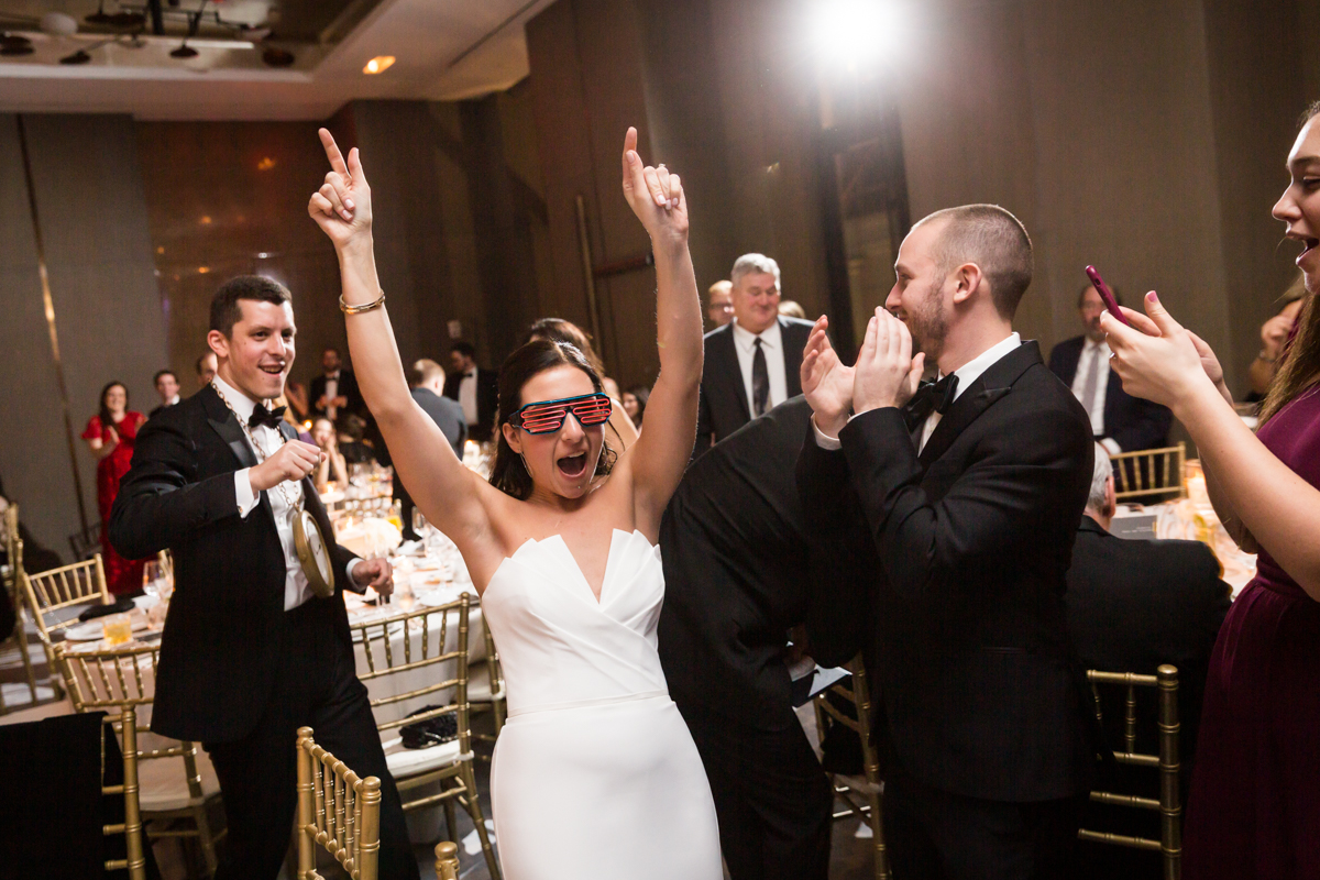 Bride and groom entering reception room at a Four Seasons Hotel New York Downtown wedding