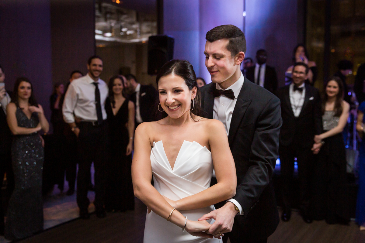 Groom looking at bride during first dance at a Four Seasons Hotel New York Downtown wedding