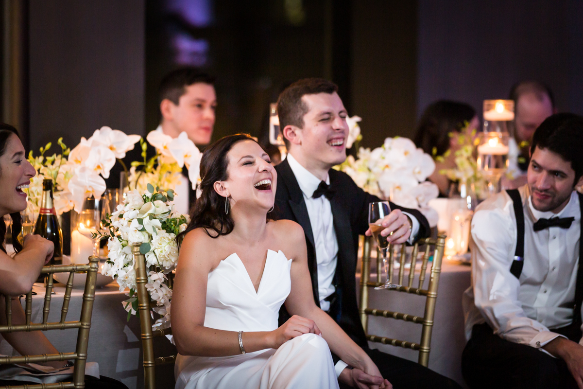 Bride and groom laughing during toasts at a Four Seasons Hotel New York Downtown wedding