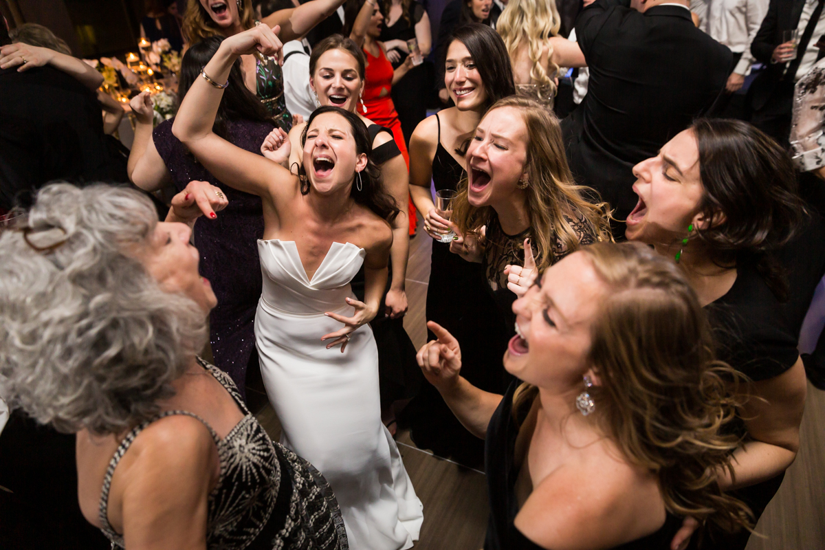 Bride dancing with guests at Four Seasons Hotel New York Downtown wedding reception