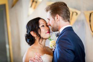 Bride and groom dancing close at reception