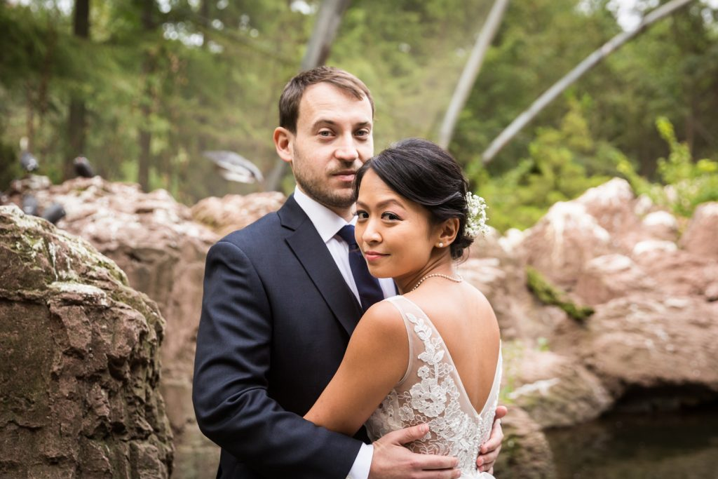 Bride and groom portrait in Aquatic Bird House at Bronx Zoo