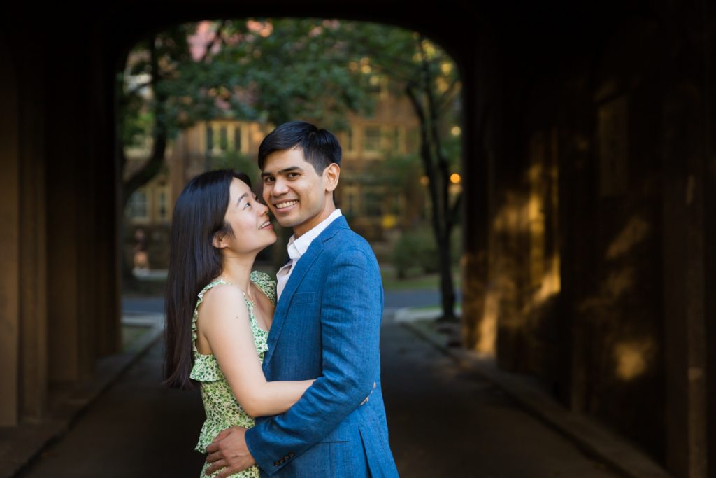 Couple in dark archway during Forest Hills engagement shoot