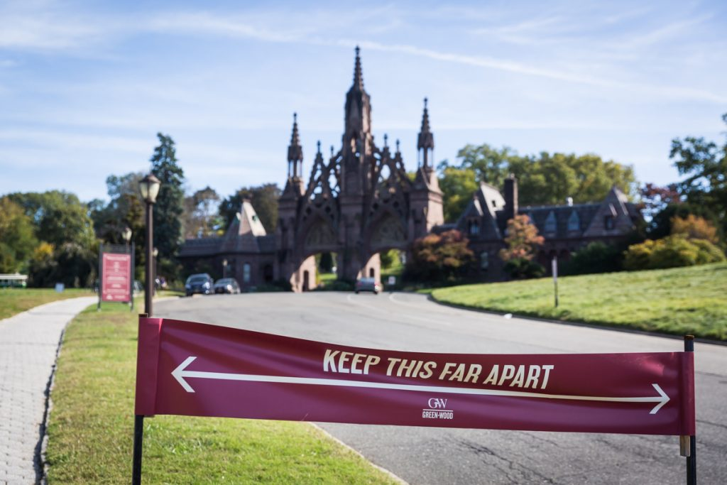 Social distancing sign in front of Green-Wood Cemetery entrance