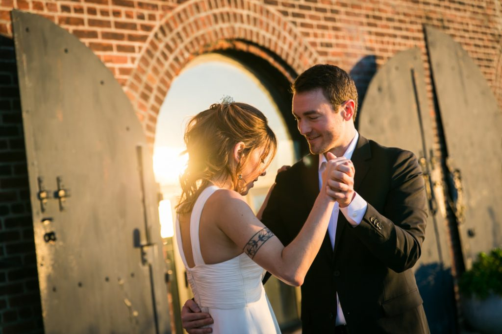 Bride and groom dancing on Red Hook pier in Brooklyn