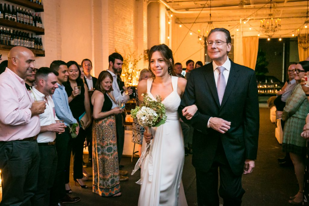 Bride and father coming down aisle at an Atelier Roquette wedding