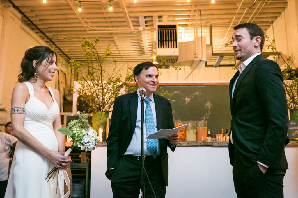 Bride and groom exchanging vows at an Atelier Roquette wedding