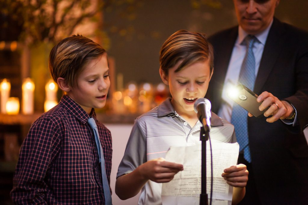 Young boys speaking during ceremony at an Atelier Roquette wedding