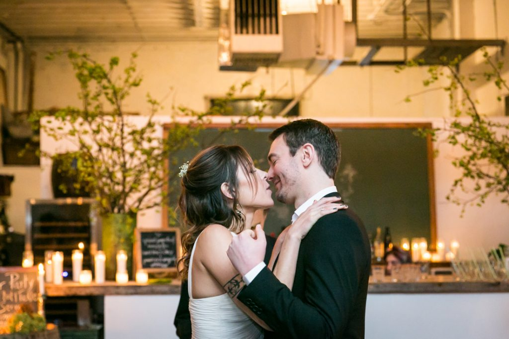 Bride and groom kissing after ceremony at an Atelier Roquette wedding
