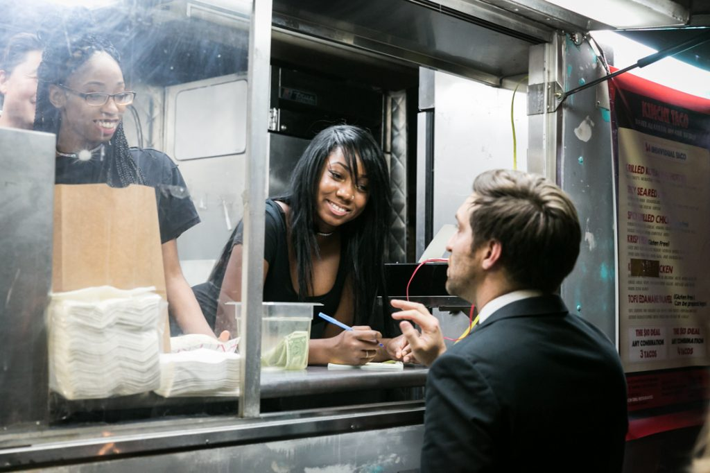 Wedding guest getting food from a food truck