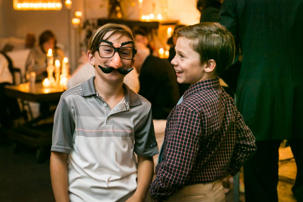 Young boys wearing disguises at wedding ceremony
