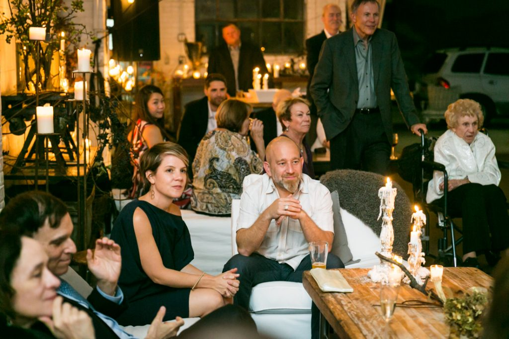 Guests listening to toasts at an Atelier Roquette wedding