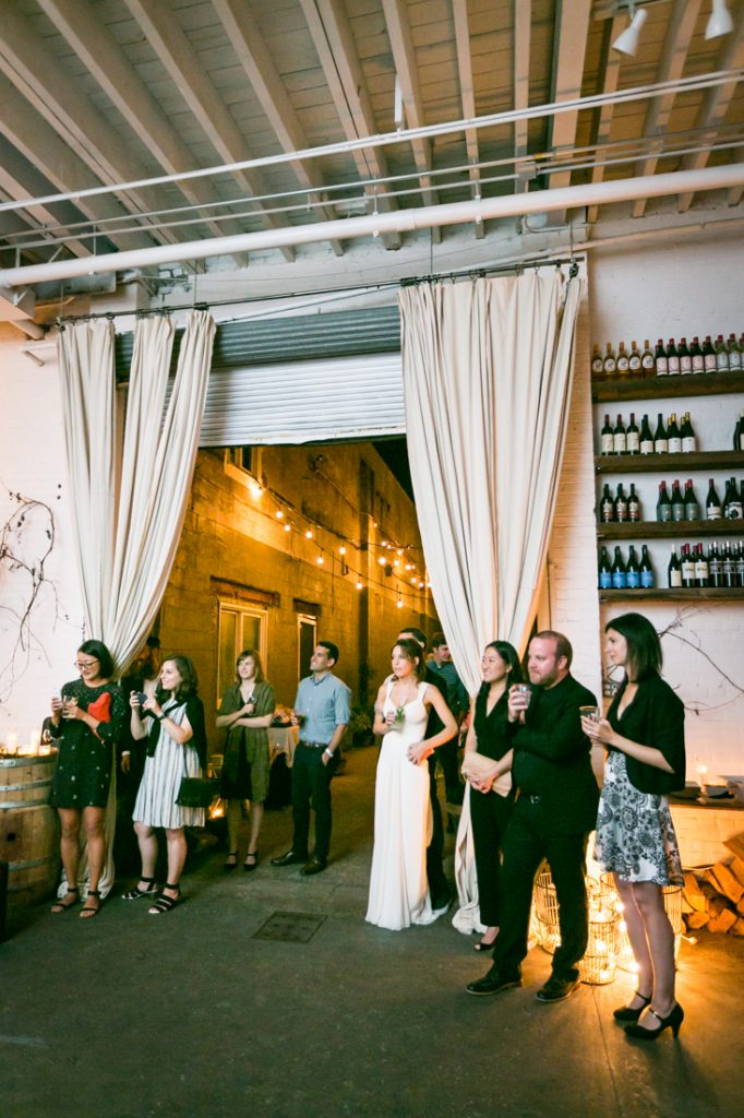 Guests listening to speeches at an Atelier Roquette wedding