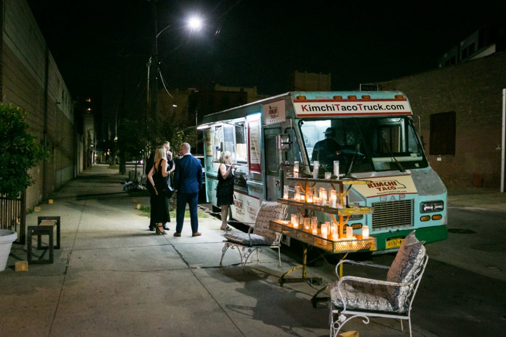 Guests getting food from a food truck