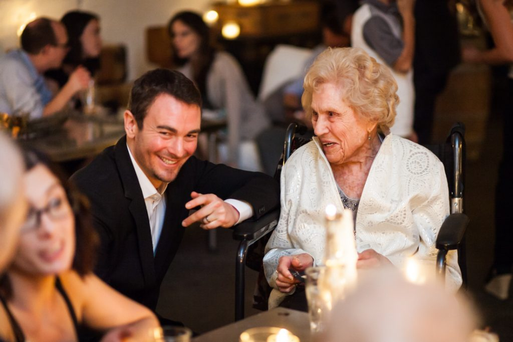 Groom speaking with grandmother at an Atelier Roquette wedding