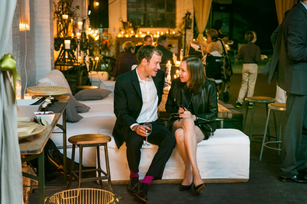 Guests chatting on a sofa at an Atelier Roquette wedding
