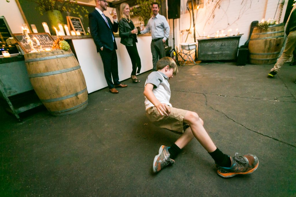 Young boy breakdancing at an Atelier Roquette wedding