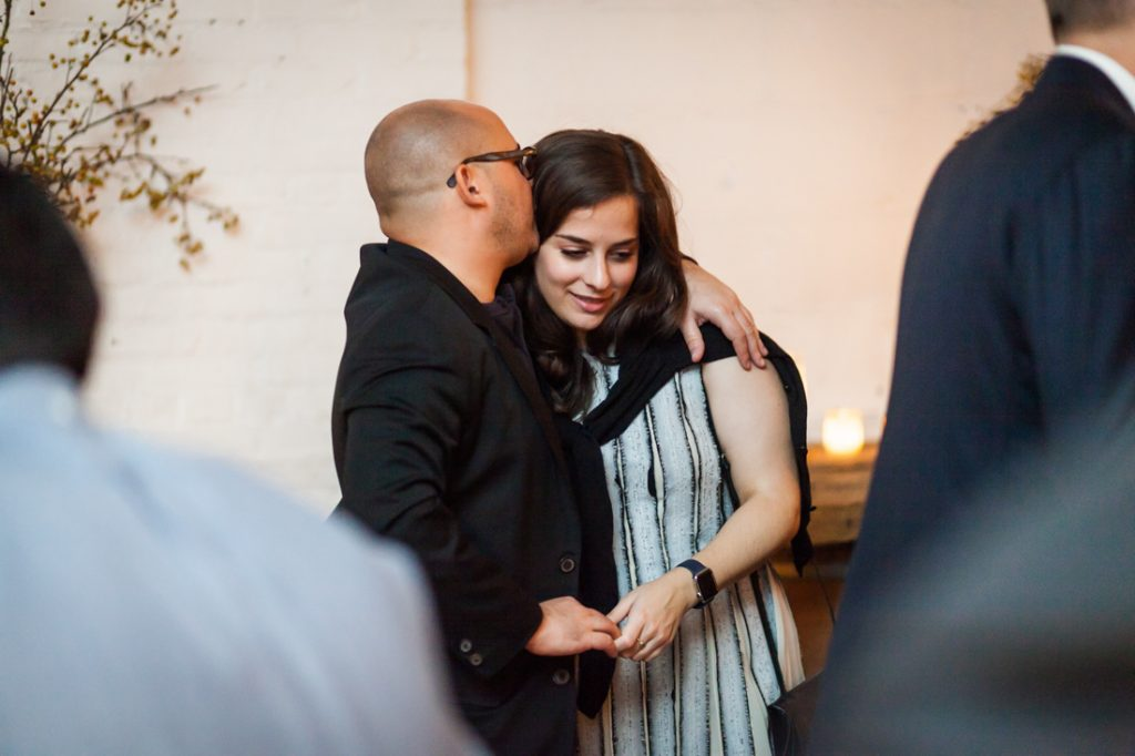 Man kissing woman at an Atelier Roquette wedding