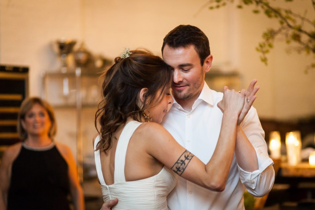 Bride and groom dancing at an Atelier Roquette wedding