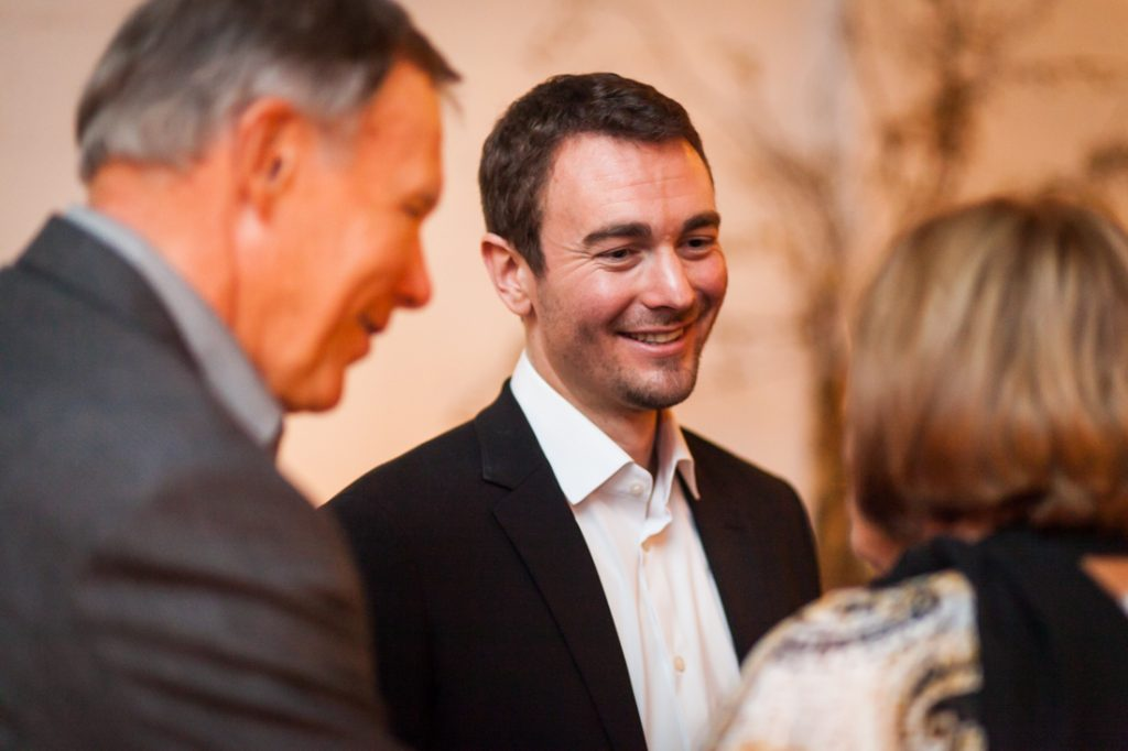 Groom chatting with guests at an Atelier Roquette wedding