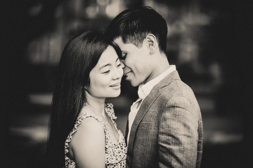 Black and white photo of engaged couple hugging