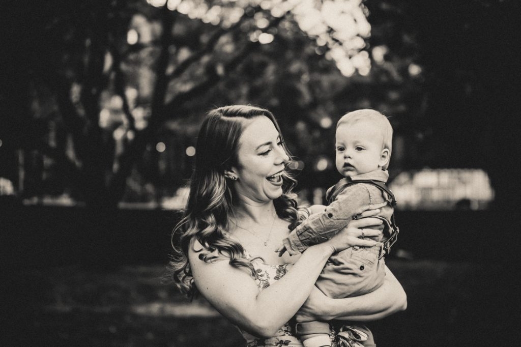 Black and white photo of mother holding baby boy