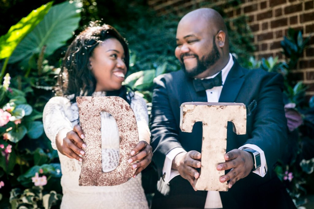 Bride and groom holding out D and T initials